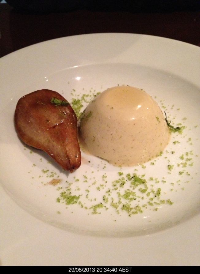 Cardamon panna cotta with poached pear and basil suagr