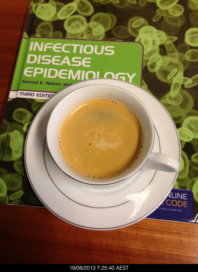 Coffee with a new textbook that I bought