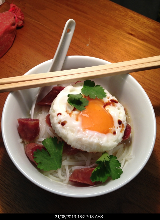 This is a delightfully light meal of rice noodles, Chinese sausage and a fried egg.