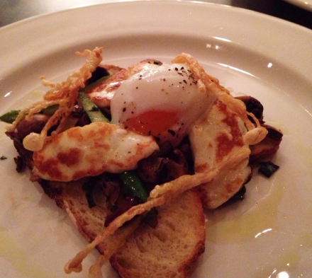 Exotic mushrooms served with grilled haloumi and a poached egg on toast