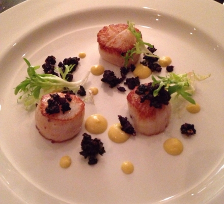 Pan-seared scallops with black pudding crumble, corn puree and frisèe
