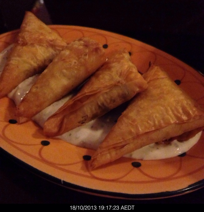 Spicy lamb boureks, filo pastry wrapped parcels with lamb and pine nuts $15
