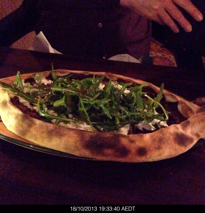 Spit roasted lamb thinly sliced and topped with rocket salad and a sprinkling of sumac