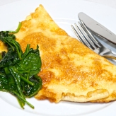 A simple breakfast of a Gorgonzola omelet with some spinach.