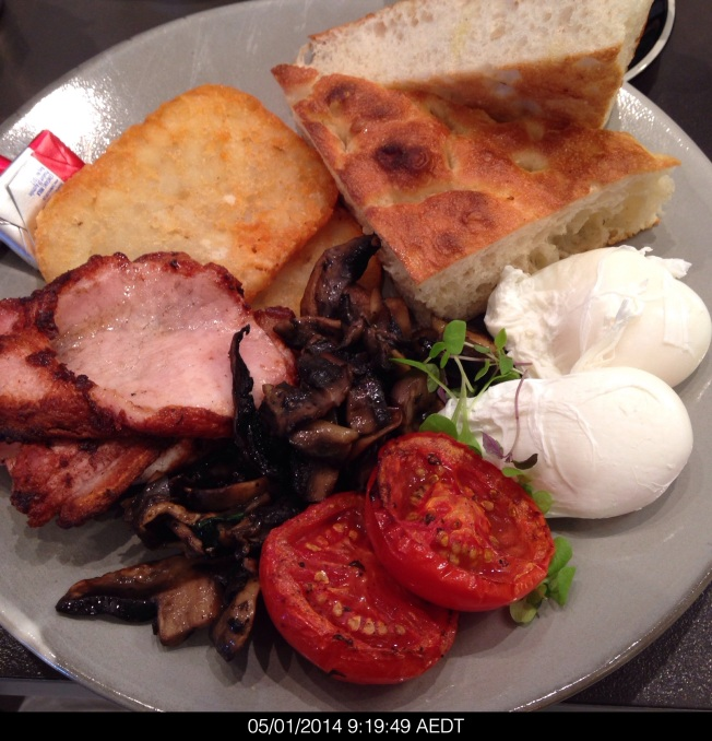 Sunday 2014-01-05 09.19.46 AEDT Ricardo's cafe big breakfast with thick bread, hashed browns, poached eggs (soft runny yolks), mushrooms, bacon and tomato.