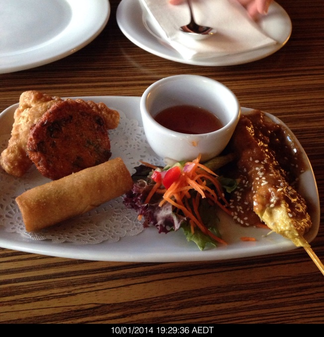 Friday 2014-01-10 19.29.34 AEDT Mixed entrée of chicken satay, fish cake, curry puff and spring roll.