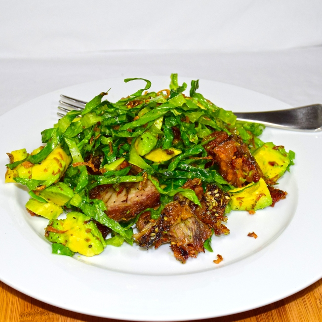 Sunday 2014-01-19 18.17.40-1 AEDT Warm lamb salad made with roast lamb, cos lettuce, avocado, and fried shallots.