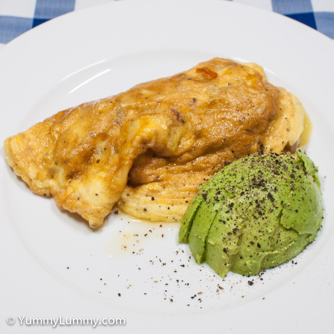Tuesday 2014-02-11 06.03.51 AEDT This breakfast omelet contains spam, lamb, Coon, Stilton blue and smoked cheddar. Served with avocado and pepper too.