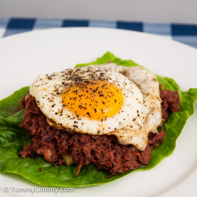 Fried egg on hashed corned beef with Coon cheese atop a cos lettuce leaf.