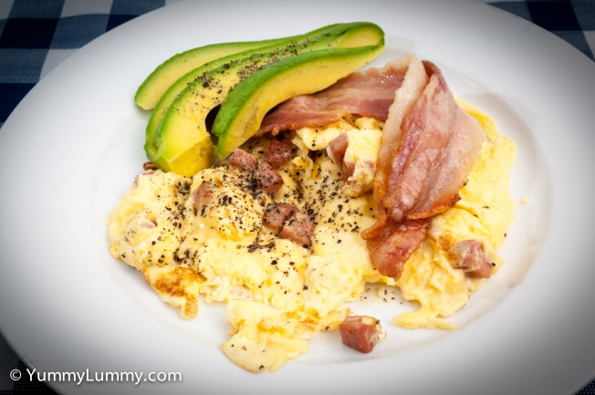 Breakfast of bacon, scrambled eggs with Don Strasbourg and avocado.