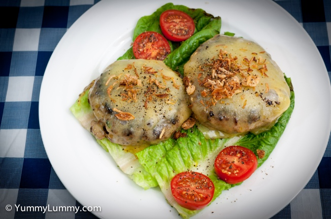 Dinner of a nude burger with Coon cheese, tomato and lettuce. The burger was made with regular mince, pecan nut meal, coriander, a beaten egg, Worcestershire sauce, olive oil, mixed fried herbs and pepper.