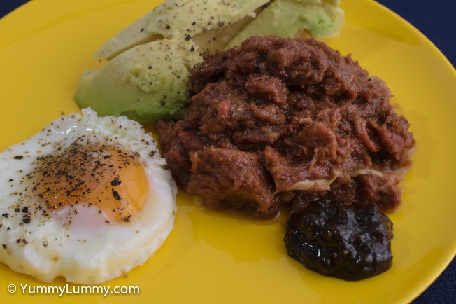 Pay day #breakfast of New Zealand corned beef with a fried egg, some avocado and a dollop of chilli chutney #delicious