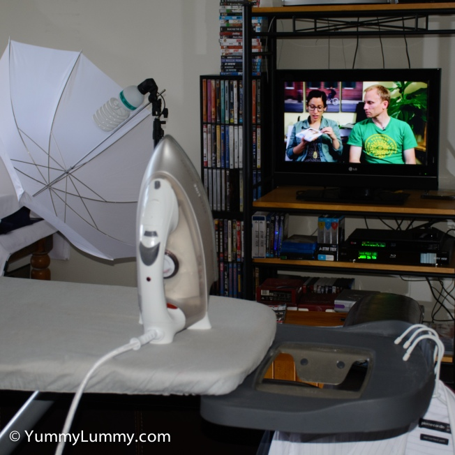 Watching a photography YouTube video while ironing