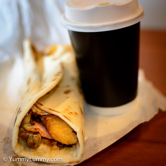 This morning's #breakfast is a Mavi special breakfast wrap with a regular flat white #coffee.