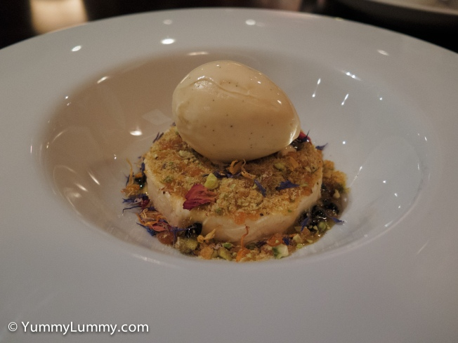 Passionfruit parfait with vanilla ice cream, pistachio praline, syrup and dried flowers