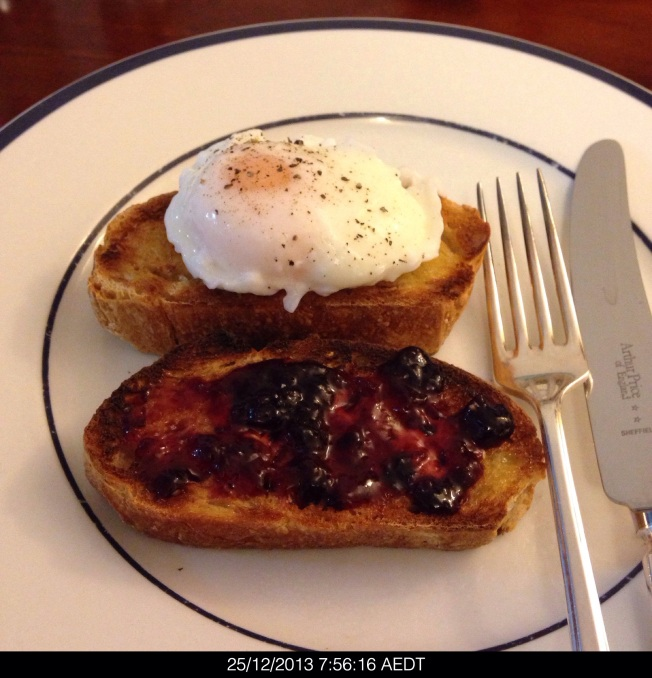 Tuesday 2013-12-25 07.56.14 AEDT First breakfast was poached egg on sourdough rye bread