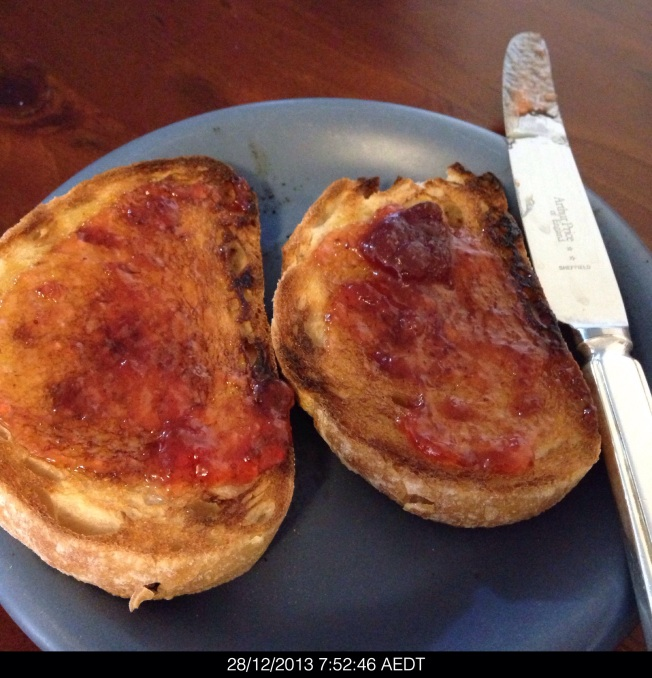 Saturday 2013-12-28 07.52.44 AEDT jam on sourdough bread for breakfast.