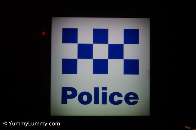 The police sign outside the Belconnen Police station on Benjamin Way.
