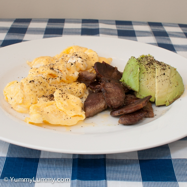 Monday 2014-02-24 08.15.36 AEDT Scrambled eggs, lamb and avocado. Two large free range eggs, ⅓ cup of cream, 61 g lamb, 85 g avocado.
