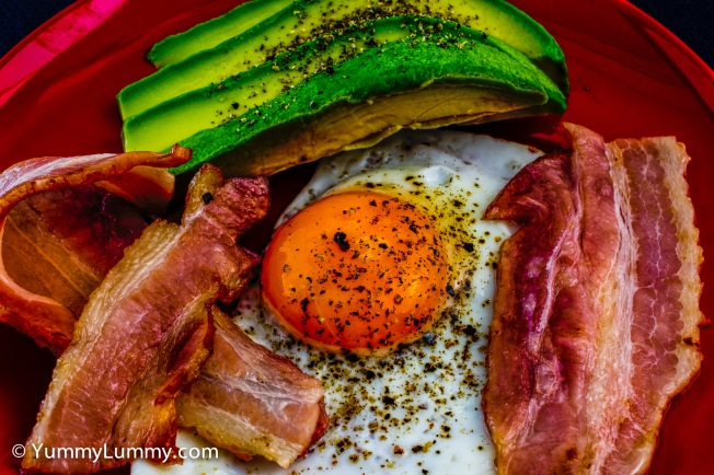 Birthday bacon and eggs with avocado in HDR.