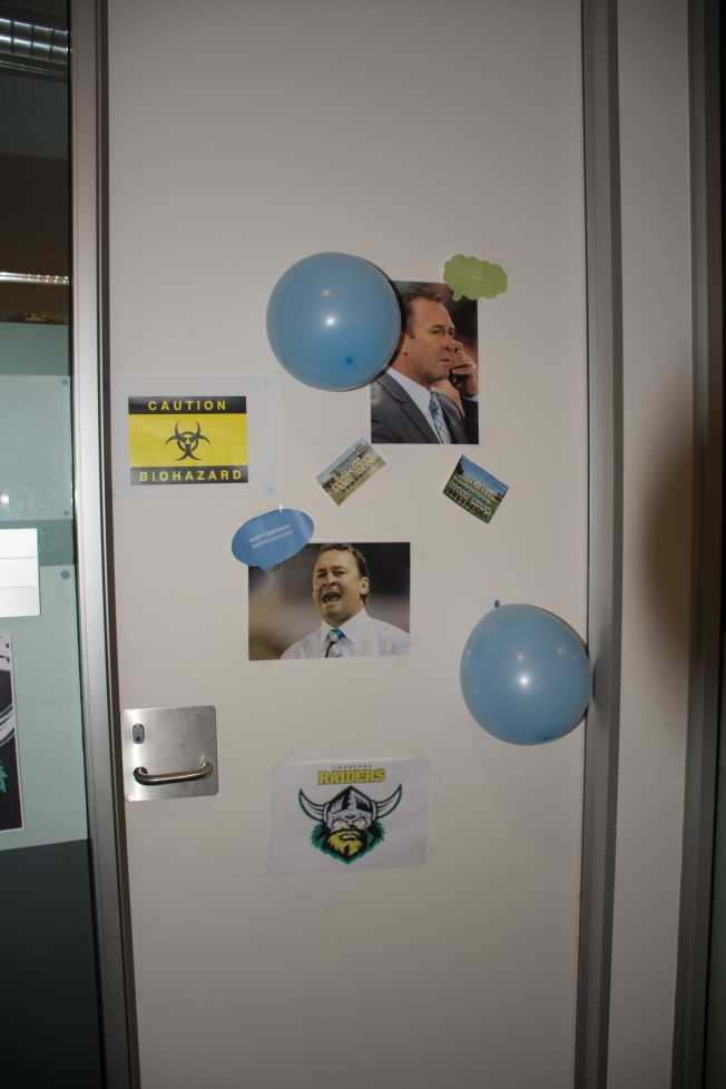 My work area was decorated for my birthday with team colours I do not support, e.g., Canberra Raiders and NSW Blues.