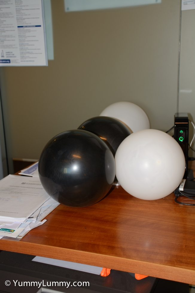 My work area was decorated for my birthday with team colours I do not support, e.g., black and white for Collingwood.