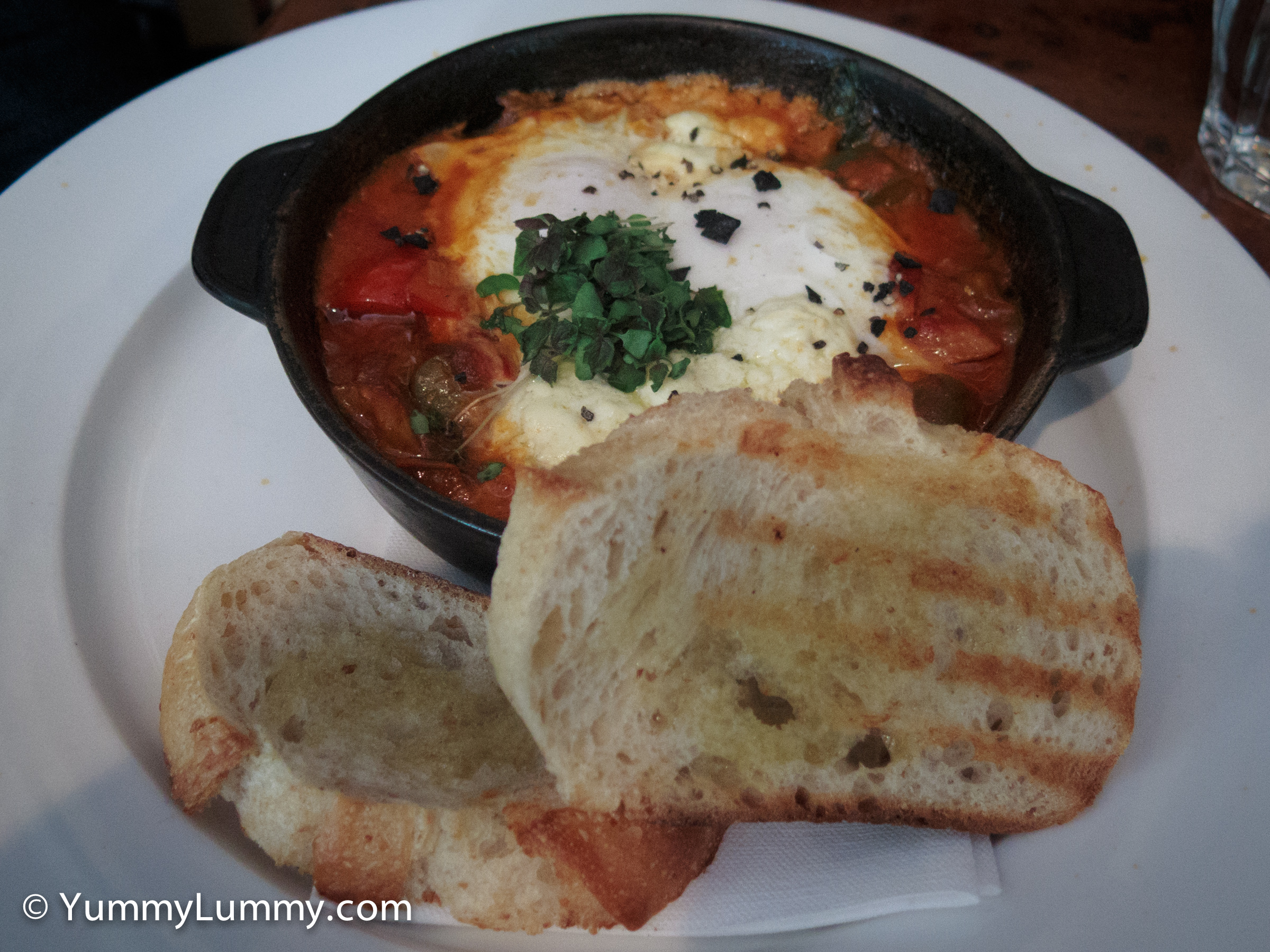 Shakshuka baked eggs with sweet peppers, tomato, spinach, creamed fetta and toast